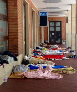 Migrants sleeping at platform one, San Giovanni train station in Como.